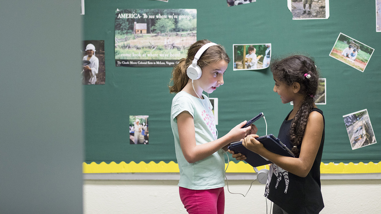 Middle school students with devices