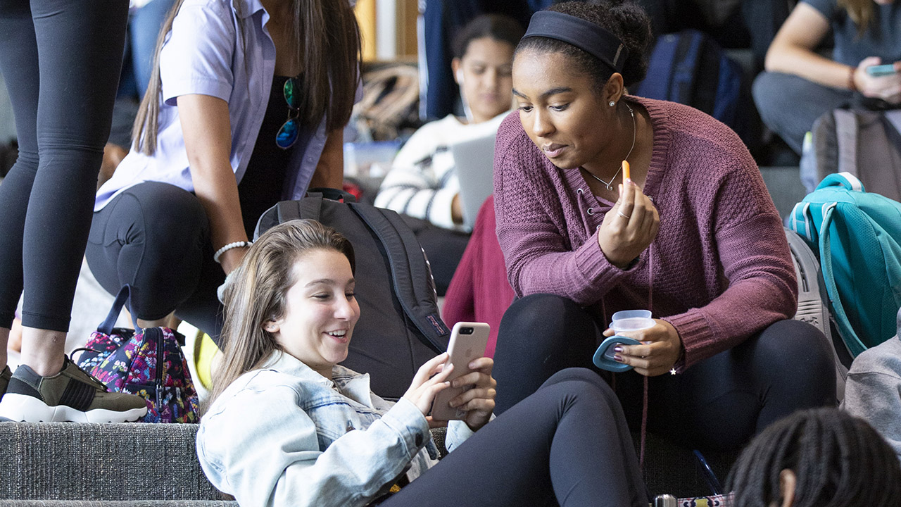 Students using cell phones.