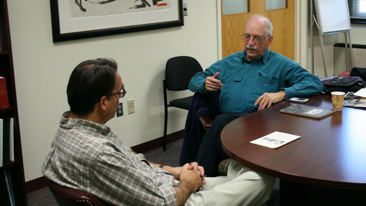 Associate head of school Kevin Barr speaks with GDS alum Professor Arthur (Pat) Goldschmidt
